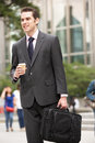 Businessman Walking Along Street Royalty Free Stock Photo