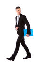 Businessman walking with blue folder Royalty Free Stock Photo