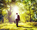 Businessman Walking Outdoors Nature Woods Concept Royalty Free Stock Photo