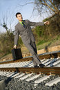 Businessman Walking on Railroad Tracks Royalty Free Stock Images