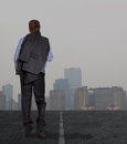 Businessman walking on road lonely a Stock Photography