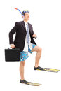 Businessman walking with scuba fins full length portrait of a isolated on white background Royalty Free Stock Images