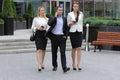 Businessman walking on the street with their secretaries Royalty Free Stock Photo