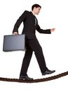 Businessman walking a tightrope Royalty Free Stock Photo