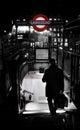 Businessman walking to metro station in London