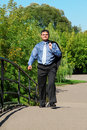 Businessman walks outdoor in summer Royalty Free Stock Photos