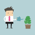 stock image of  Businessman watering money plant vector