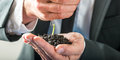 Businessman watering a sprouting seedling