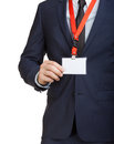 Businessman wearing a blank ID tag or name card on a lanyard at an exhibition or conference