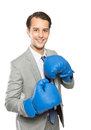 Businessman wearing a boxing gloves Royalty Free Stock Photo