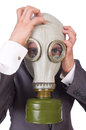 Businessman wearing gas mask isolated on white Stock Photo