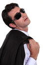 Businessman wearing shades with over his shoulder Stock Images