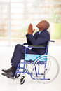 Businessman wheelchair praying Royalty Free Stock Photos