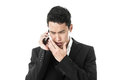 Businessman whispering to a phone in suit Stock Image