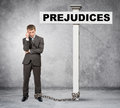 Businessman word prejudice on post sign thinking with chain Stock Images