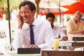Businessman Working On Digital Tablet In Outdoor Caf�