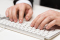 Businessman working with keyboard business technology internet and office concept close up of hands Stock Photos