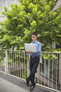 Businessman working outdoors with his laptop Royalty Free Stock Photo