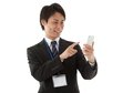 Businessman working with smartphone Stock Images