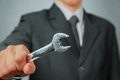 Businessman with wrench Royalty Free Stock Photo