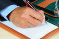 Businessman writing in note pad Royalty Free Stock Image
