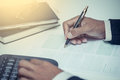 Businessman writing  with pen and working in the office Royalty Free Stock Photo