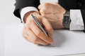 Businessman writing something on the paper Royalty Free Stock Photo