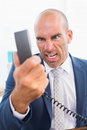Businessman yelling at his phone Royalty Free Stock Photo