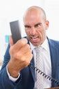 Businessman yelling at his phone Royalty Free Stock Photo