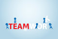 Businessmen assembling the teamwork word, business concept
