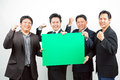 Businessmen with banner team of holding a blank green Stock Image