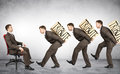 Businessmen carry boxes with word tribute Royalty Free Stock Photo