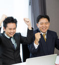 Businessmen celebrate their business success Stock Images