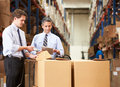 Businessmen Checking Boxes With Digital Tablet And Scanner Royalty Free Stock Photo