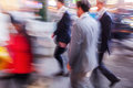 Businessmen in the city in motion blur Royalty Free Stock Photo