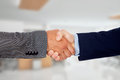 Businessmen closing a deal with handshake Stock Photography
