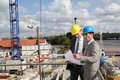 Businessmen on construction site Royalty Free Stock Photos