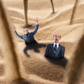 Businessmen fall into the trap two quicksand Royalty Free Stock Image