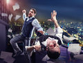 Businessmen fighting two on the roof against night cityscape Stock Images