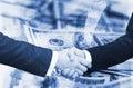 Businessmen handshake on dollar background Royalty Free Stock Photo