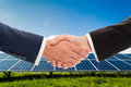 Businessmen handshake on solarpower photovoltaic panel backgroun Royalty Free Stock Photo