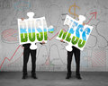 Businessmen holding two puzzles to assemble for green business Royalty Free Stock Photo