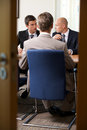 Businessmen in meeting at board room Royalty Free Stock Photo