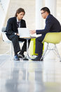 Businessmen Meeting With Laptop In Modern Office Royalty Free Stock Images