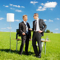 Businessmen in a meeting in nature two businesspersons planning something green meadow Royalty Free Stock Photography