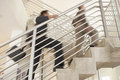 Businessmen Moving Upstairs In Office Royalty Free Stock Photo