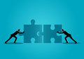 Businessmen pushing two jigsaw pieces