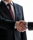 Businessmen shake hands isolated on white Stock Images