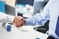 Businessmen shaking hands business deal close up of a handshake Royalty Free Stock Photography