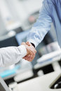 Businessmen shaking hands business deal close up of a handshake Stock Images